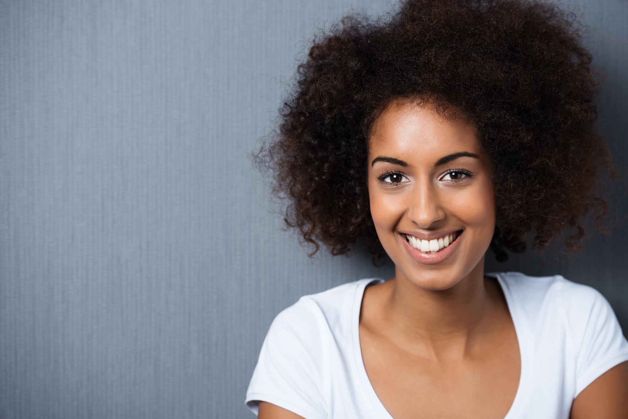 woman smiling wearing crowns Greenville, SC
