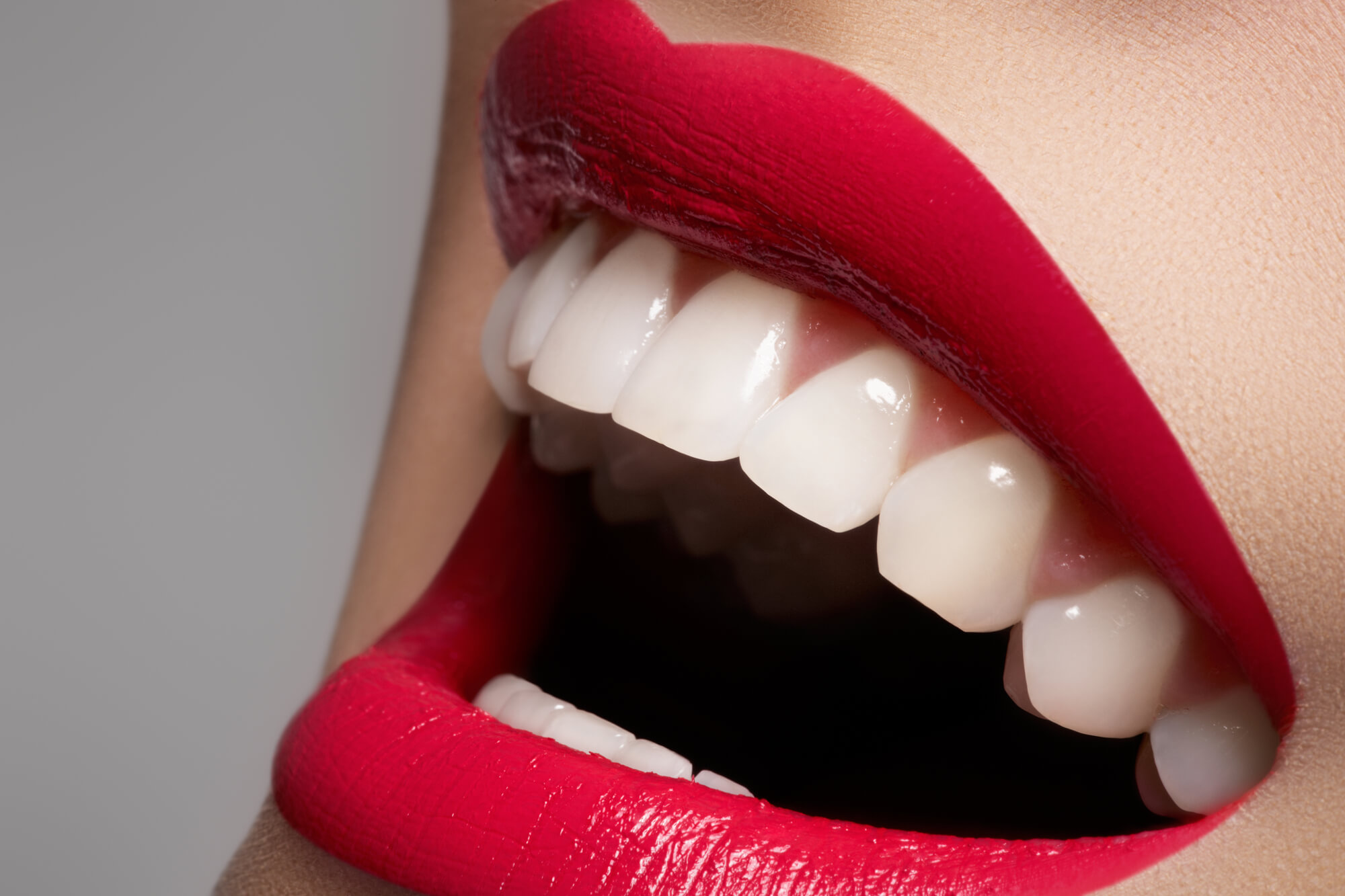 red lips and beautiful, white teeth